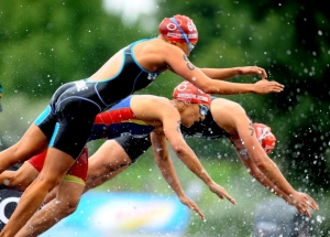 In-this-photo-released-by-the-International-Triathlon-Union-women-dive-into-the-Serpentine-at-the-2009-Triathlon-ITU-World-Championship-Series-in-London-af5